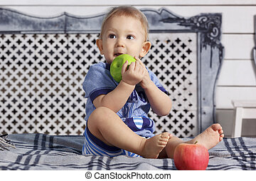 Baby boy in bed with apple - Little baby boy in parent's...