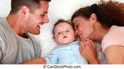 Baby boy in blue babygro with happy parents