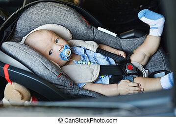 baby boy in car