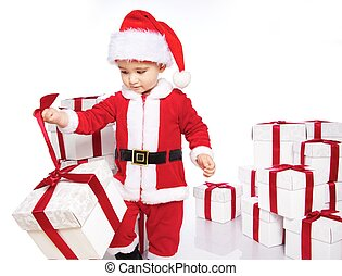 Baby boy in Santa Claus costume opening gift box