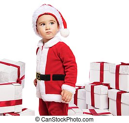 Baby boy in Santa Claus costume standing