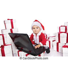 Baby boy in Santa Claus costume with notebook