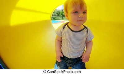Baby boy in the tube - Baby boy riding a child swing on ...