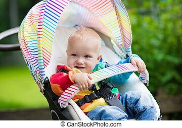 Baby boy in white stroller