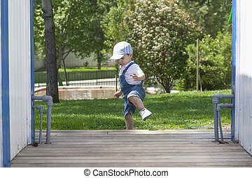 Baby boy learning to walk by himself. He is learning to to...