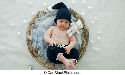 baby boy lying in a basket with fur hat-knitting gnome in my...