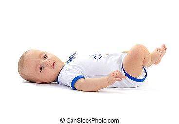baby boy lying on white floor