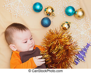 Baby boy lying with christmas decoration