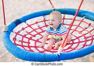 Baby boy on a swing