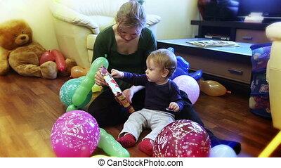 Baby boy opening present