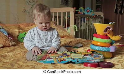 Baby boy play with him toys