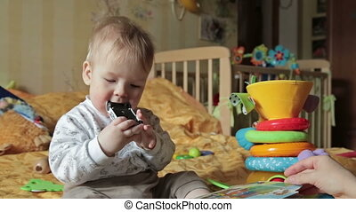 Baby boy play with toy