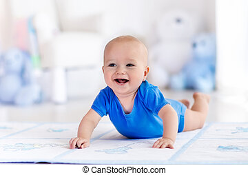 Baby boy playing and learning to crawl - Adorable baby boy...