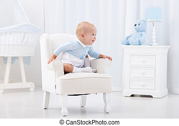 Baby boy playing in bedroom - Adorable baby boy playing in...