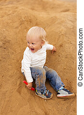 Baby Boy Playing in the Sandbox