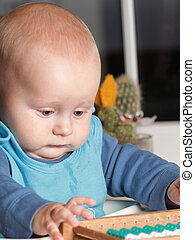 baby boy playing indoor