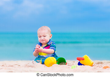 Baby boy playing on a beach