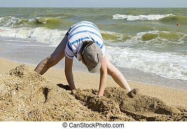 boy playing on beach