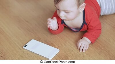 Baby boy playing with a smartphone