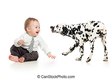 baby boy playing with puppy dog