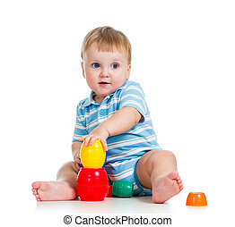 baby boy playing with toys, isolated over white
