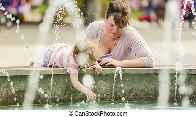 Baby Boy Playing With Water In Fountain