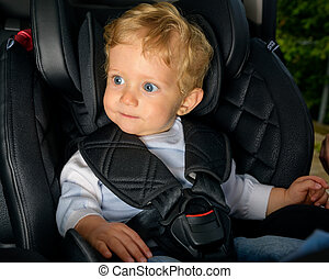 Baby Boy Sitting In A Car Seat Infant 8 Months Old