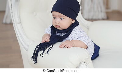 Baby boy sitting in vintage chair