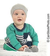 Baby boy sitting on a white background