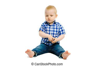 boy sitting on a white floor