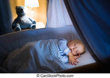 Baby boy sleeping at night - Adorable baby sleeping in blue...