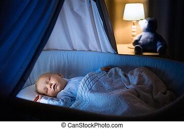 Baby boy sleeping at night - Adorable baby sleeping in blue...