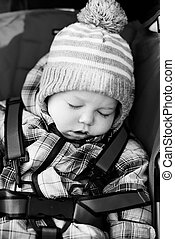 baby boy sleeping in the stroller