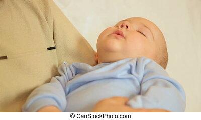 Baby boy sleeping on hands