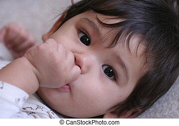 Baby boy sucking thumb