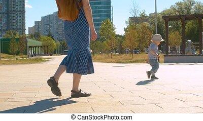 Baby boy walking in the park