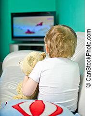 Baby boy watching cartoons