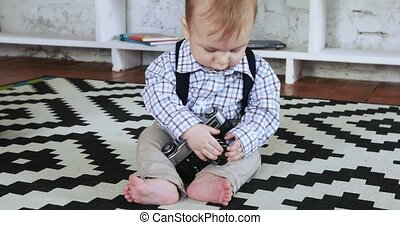 Baby boy with a camera