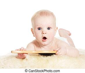 Baby boy with brush