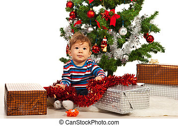 Baby boy with Christmas presents