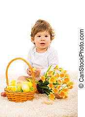 Baby boy with Easter eggs