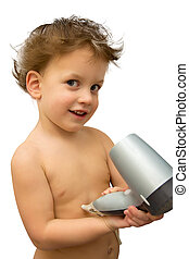 Baby boy with hair dryer over white