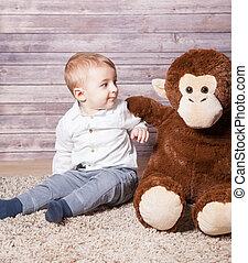 Baby boy with huge monkey toy