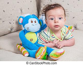 Baby boy with monkey