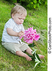 Baby boy with pink peony