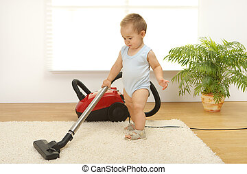Baby boy with vacuum cleaner - Baby boy cleaning the carpet ...