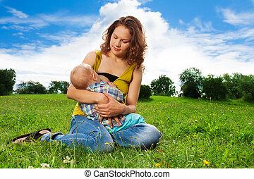 baby breastfeeding - woman breastfeeding her little son