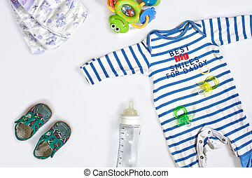 Baby care accessories and clothing on light background, top ...