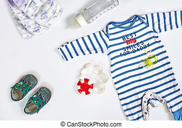 Baby care accessories and clothing on white background, top ...