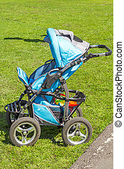 Baby carriage on grass